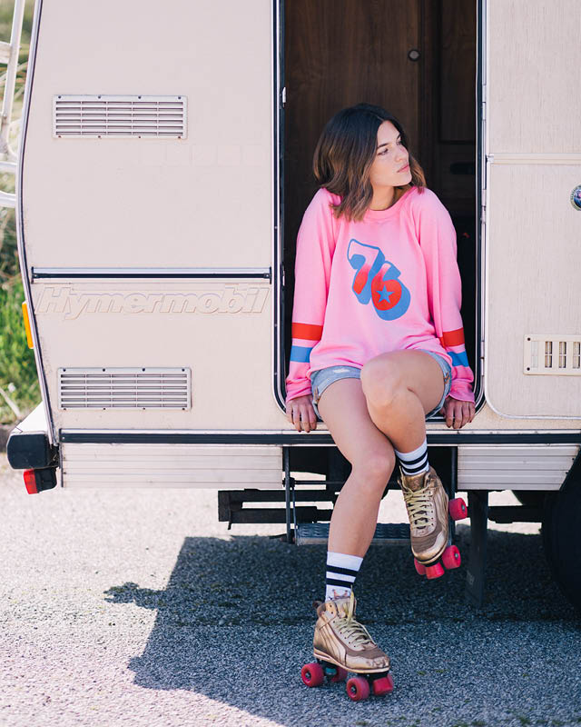 Model wearing the Wildfox Track 76 Sweater with Levi's 501 Long Highways & Byways Denim Shorts