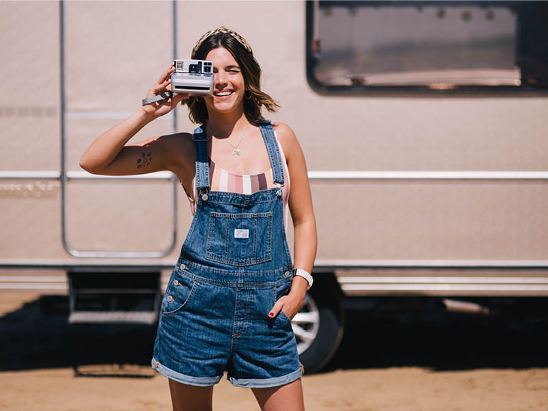 Model wearing the Levi's Vintage Shorttalls Short Cut Dungarees styled with the Rhythm Sahara Desert Swimsuit a