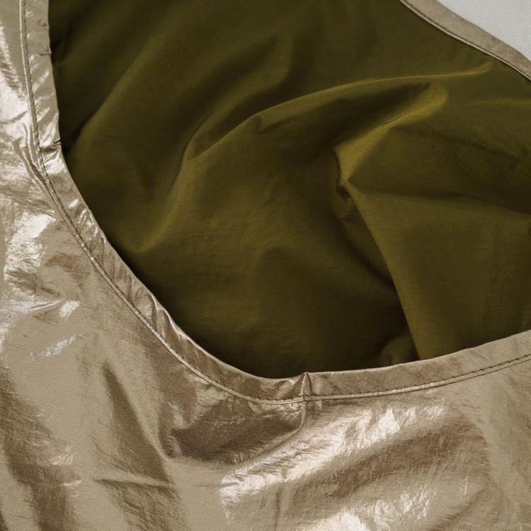 Baggu Bronze Metallic Standard Reusable Bag - detail shot of fabric + inner lining