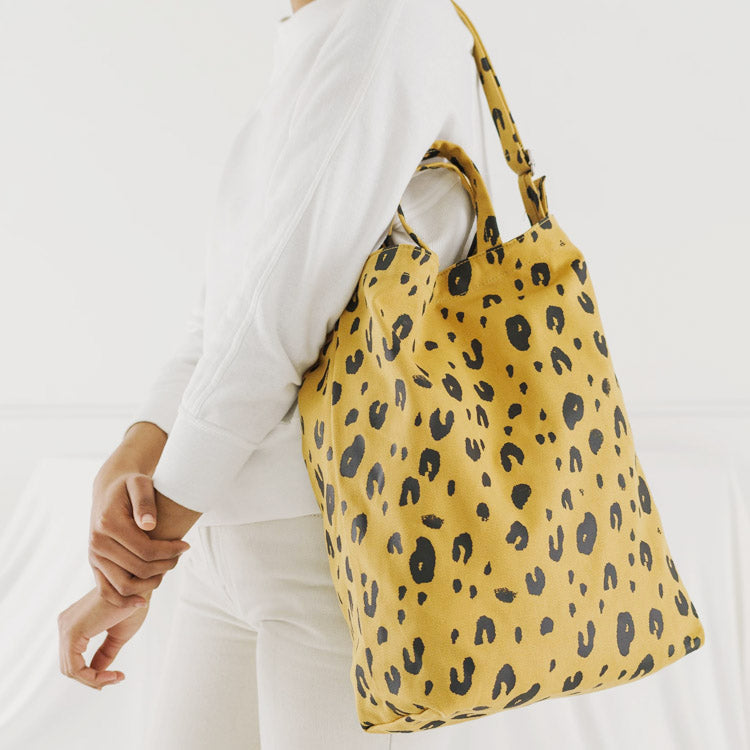 Model wearing Baggu Leopard Print Duck Bag