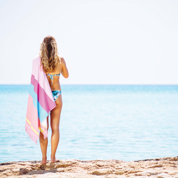 Make a bold and bright statement with the Eternal Summer Fringed Beach Towel designed exclusively by Roo's Beach