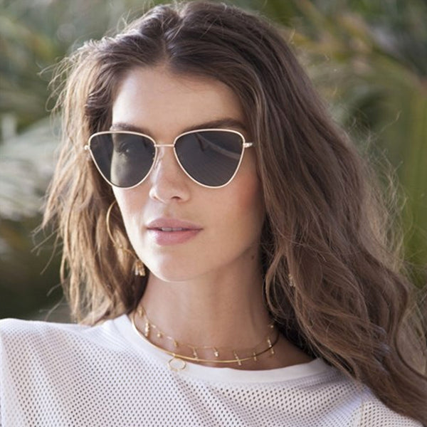 Model wearing the Le Specs Echo Matte Gold Sunglasses