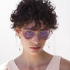 Model wearing the Le Specs Echo Matte Rose Gold Sunglasses