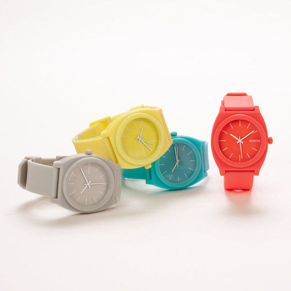 Group shot of 4 colourful Nixon Time Teller P Watches