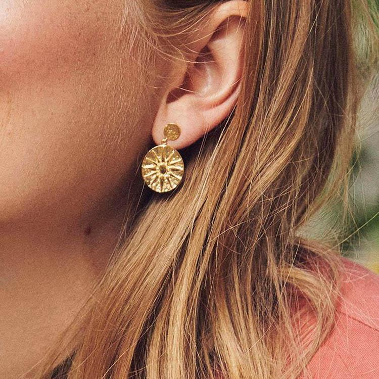 Model wearing Pernille Corydon Bali Gold 28mm Earrings