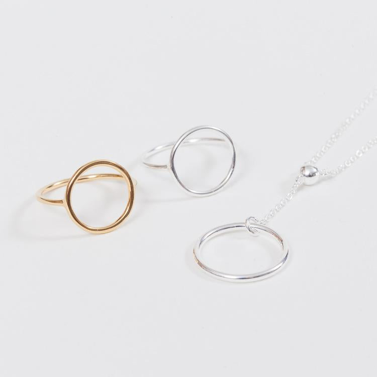 Group shot of 2 rings and necklaces from the Pernille Corydon Halo collection