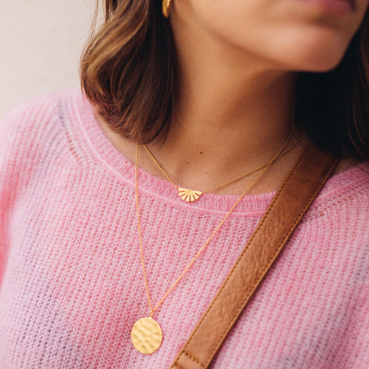 Model wearing the Pernillle Corydon Gold Dublin Necklace layered with the Gold Dawn Necklace