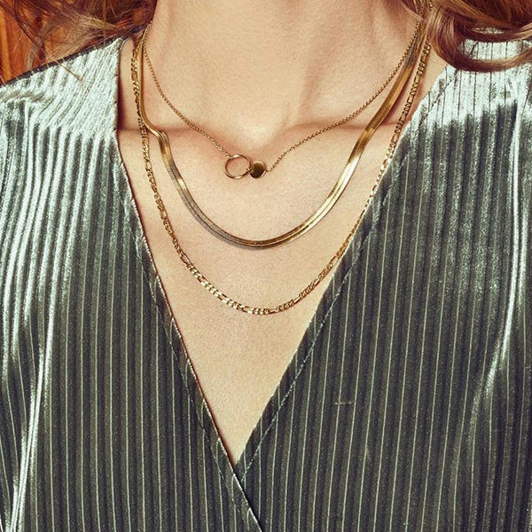 Lifestyle shot of layered Pernille Corydon necklaces on a model