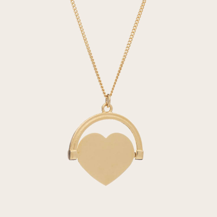 Product shot: Rachel Jackson Love Spinning Gold Necklace