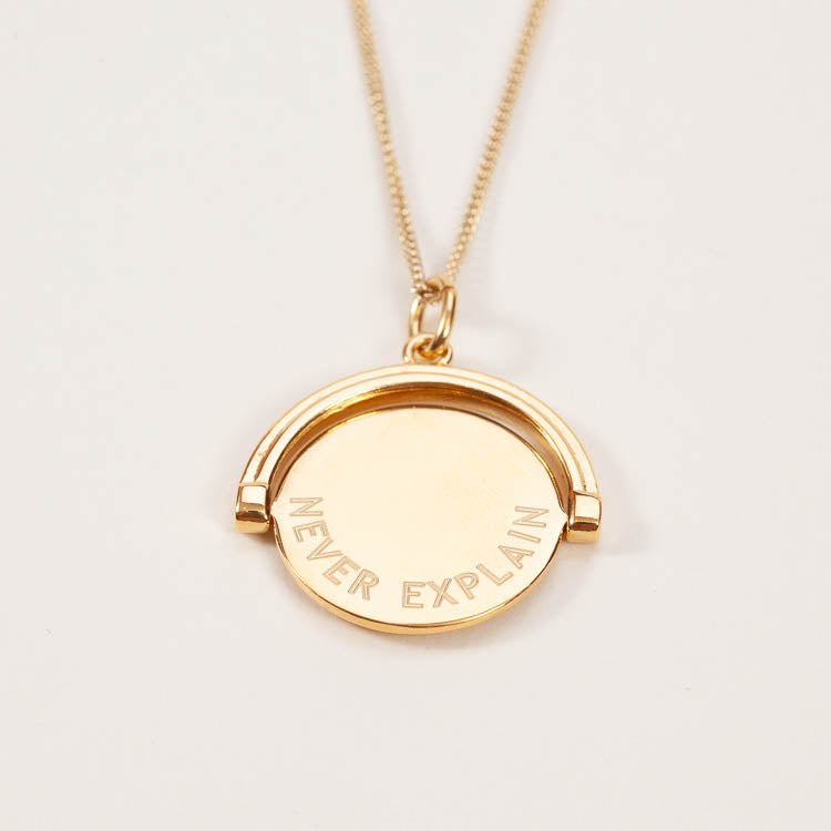 Product shot: Rachel Jackson Never Complain Never Explain Pendant Necklace