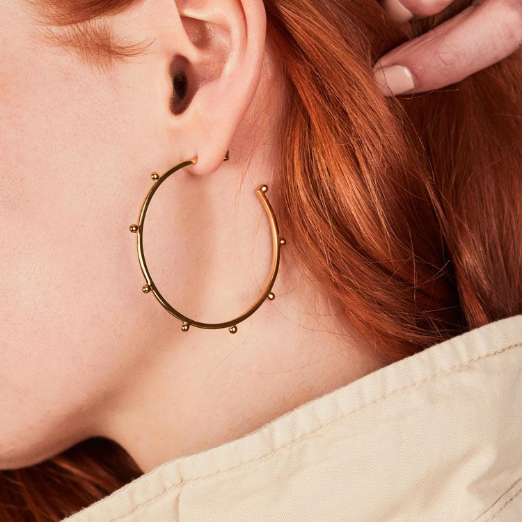 Model wearing Rachel Jackson Oversized Punk Gold Hoop Earrings