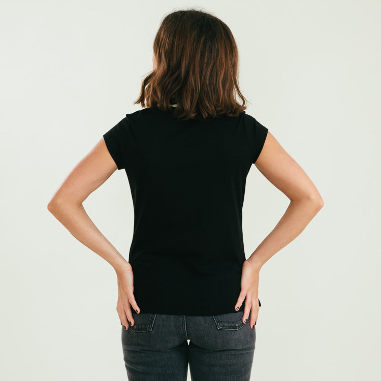 Studio model wearing the Mads Nørgaard Favourite Teasy Black Organic T-Shirt, back shot