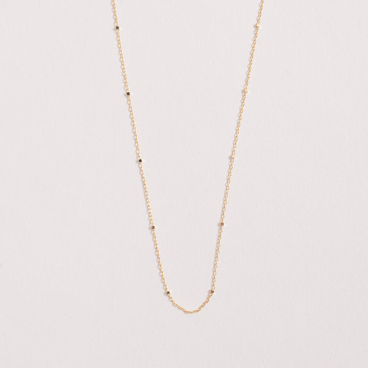 Product shot of the Pernille Corydon Saturn Gold Necklace