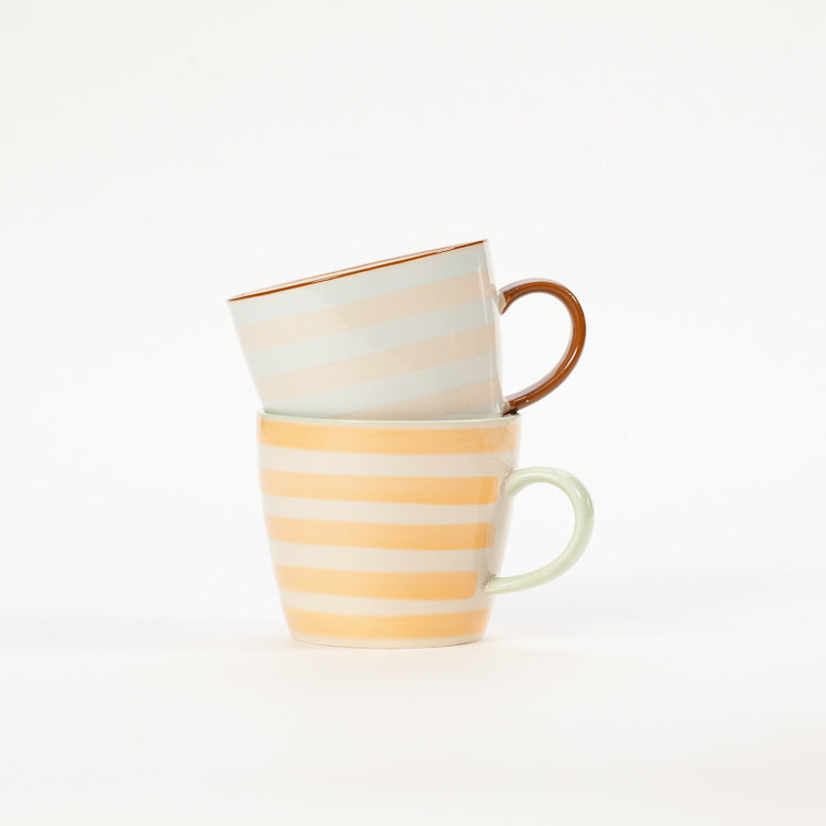 2 stacked patterned stoneware mugs from Nordic homeware brand Bloomingville