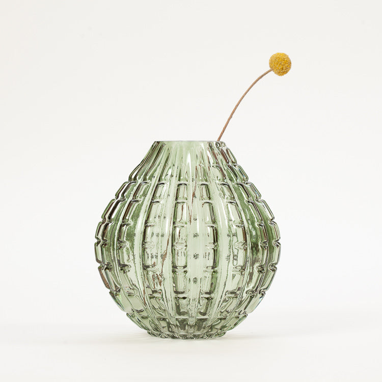 Product shot: Bloomingville Green Glass Vase with a single flower stem