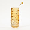 Product shot of: Bloomingville Tall Brown Bubble Glass Vase with a single flower stem