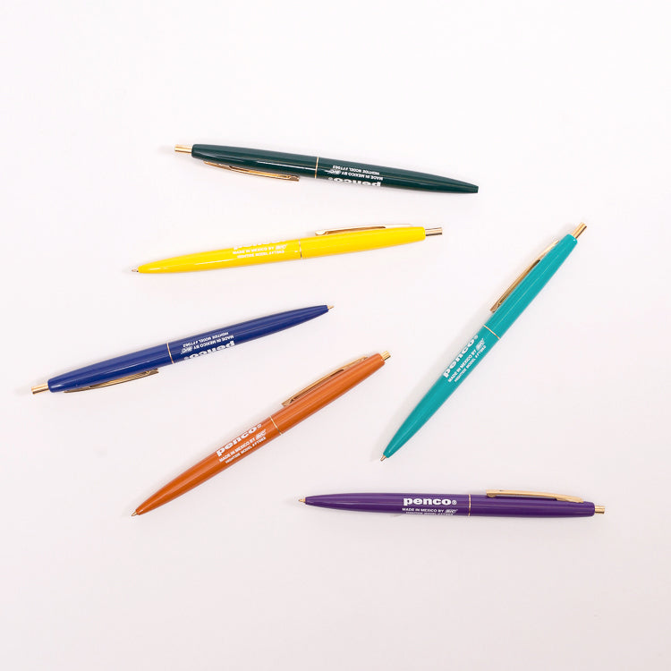 ... Product shot: 6 Penco BIC Clic Ballpoint Pens scattered on a white  background