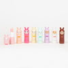 Group shot of 8 colourful INUWET Bunny lip balms