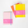 A group of 4 colourful Ashkahn A6 Notebooks