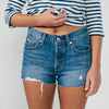 Studio model wearing the Model wearing the Levi 501 Back To Your Heart Blue Denim Shorts
