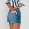 Studio model, side shot, wearing the Model wearing the Levi 501 Back To Your Heart Blue Denim Shorts