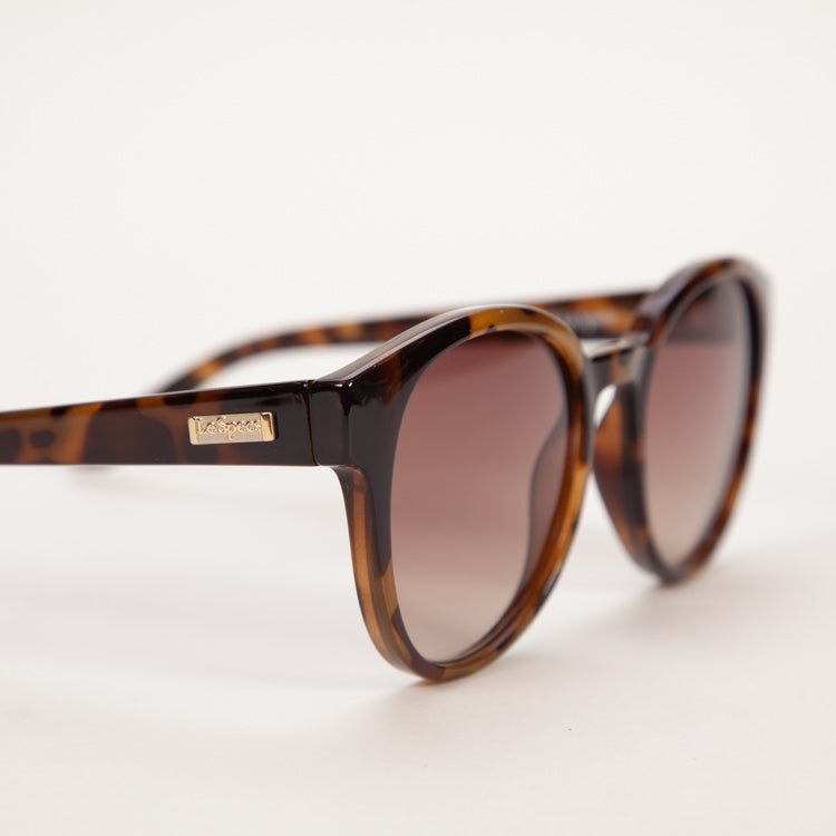 Product shot of Le Specs Paramount Milky Tort Sunglasses - Side view