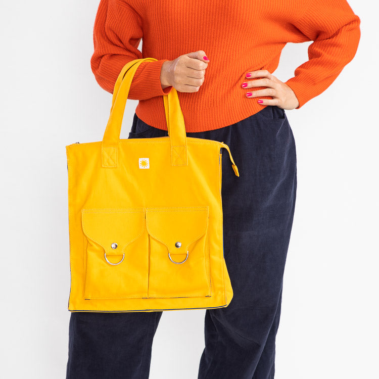 Model holding a L.F. Markey Yellow Super Shopper Tote Bag