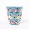 Product shot: RICE Bird & Pansy Print Melamine Cup, photographed in the studio on a white background