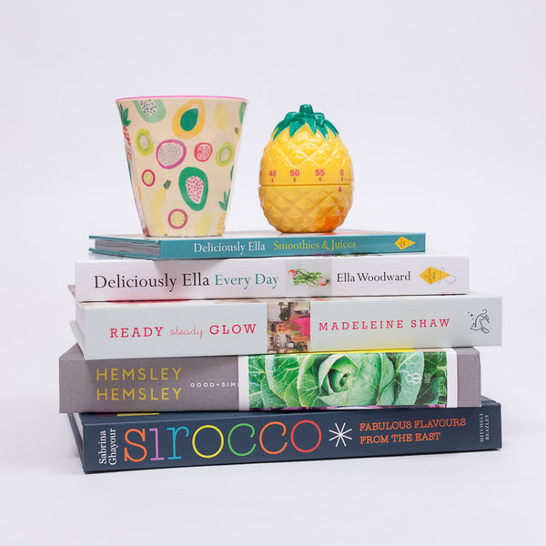 RICE Two Tone Tutti Frutti Print Melamine Cup on a stack on clean eating cookbooks available from Roo's Beach UK