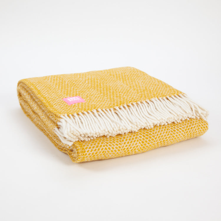 Product shot: Beehive Yellow Pure Wool Throw