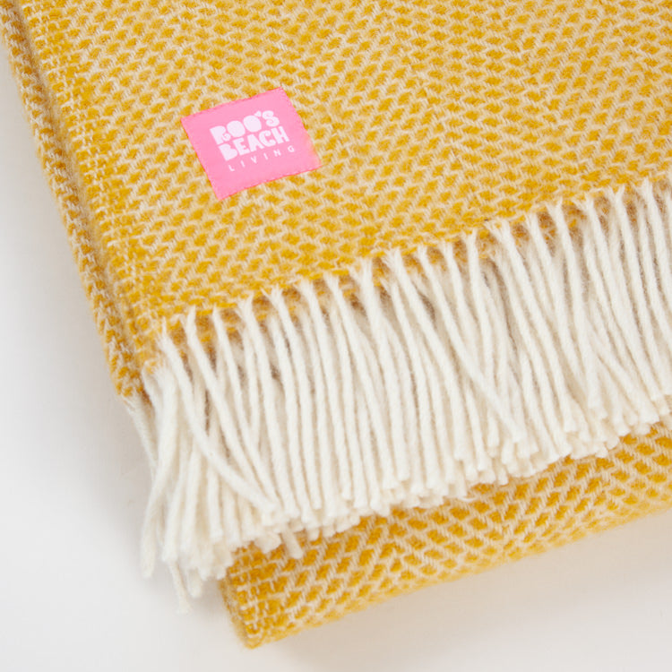 Detail shot of the fringing on the Beehive Yellow Pure Wool Throw from Roo's Beach Living