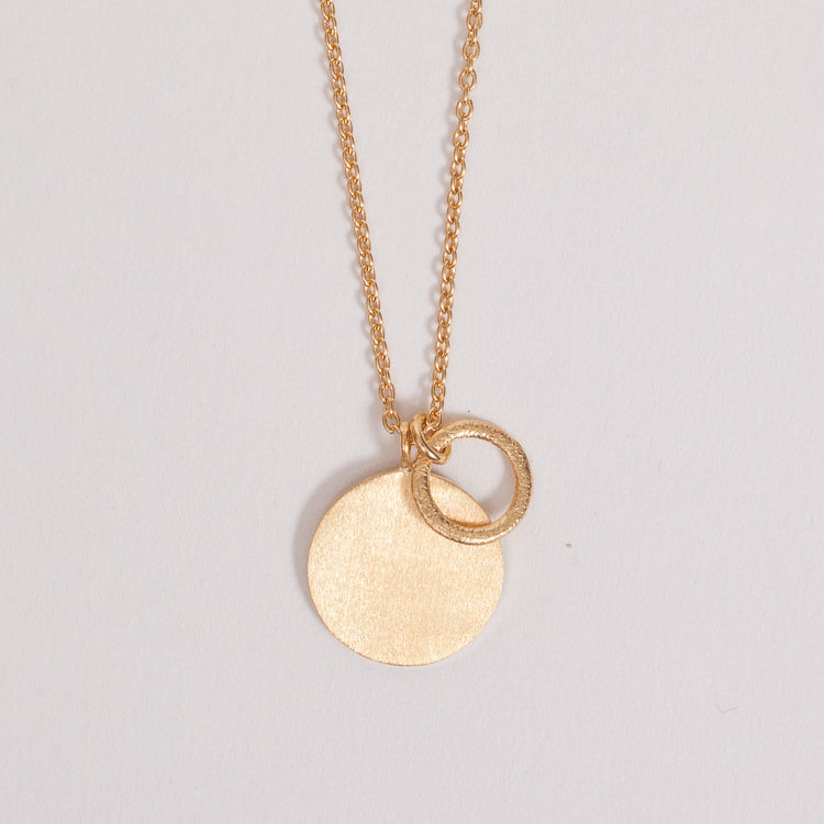Detail shot of the Pernille Corydon Gold Coin & Circle Necklace