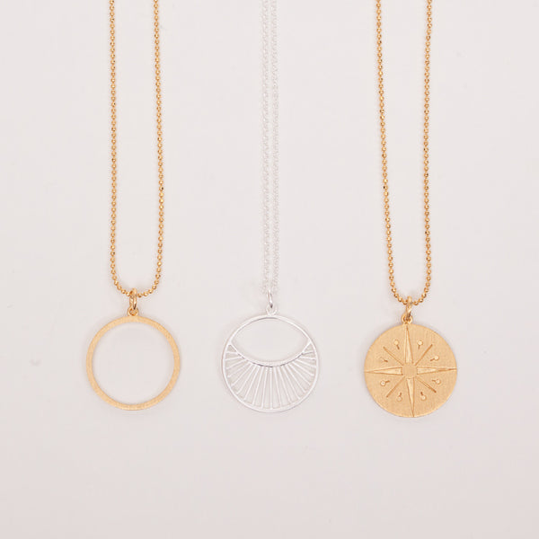 A group of 3 minimalist designed, geometric necklaces