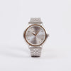 NIXON Sala Silver / Gold Watch a sophisticated bracelet style watch available from Roo's Beach UK