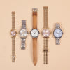A row of 5 NIXON watches in gold, silver and tan leather from a selection available from Roo's Beach UK