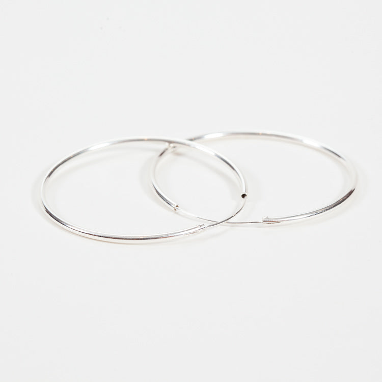 Product shot of Pernille Corydon Large Plain Silver Hoop Earrings - Side view