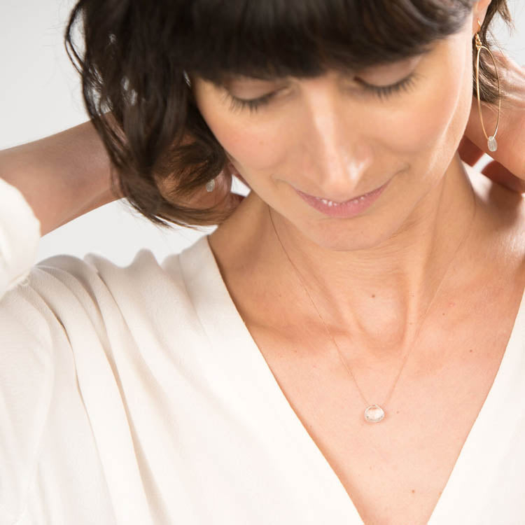Model wearing the Wanderlust Life April Birth Stone Clear Quartz Necklace