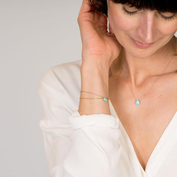 Model wearing a Wanderlust Life December Birthstone Turquoise Necklace