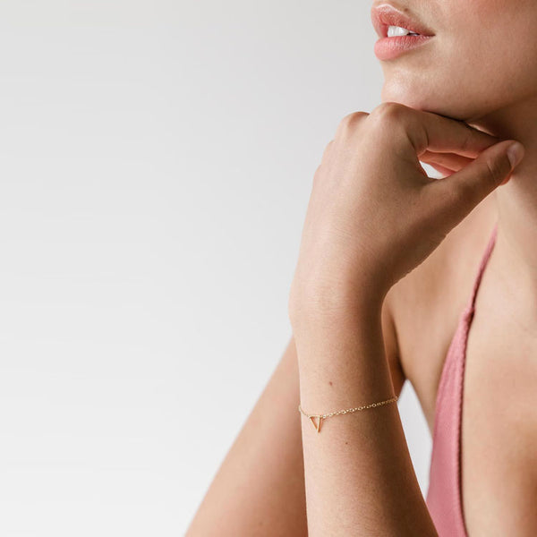 Model wearing the Wanderlust Life Fortis Triangle Kinship Friendship Bracelet