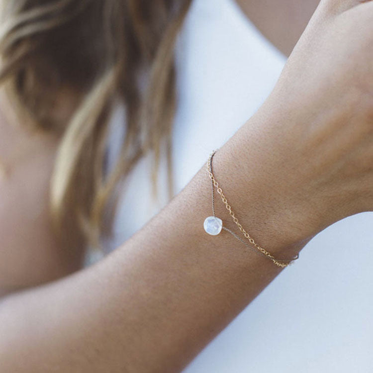 Model wearing a Wanderlust Life Gold & Rainbow Moonstone Bracelet