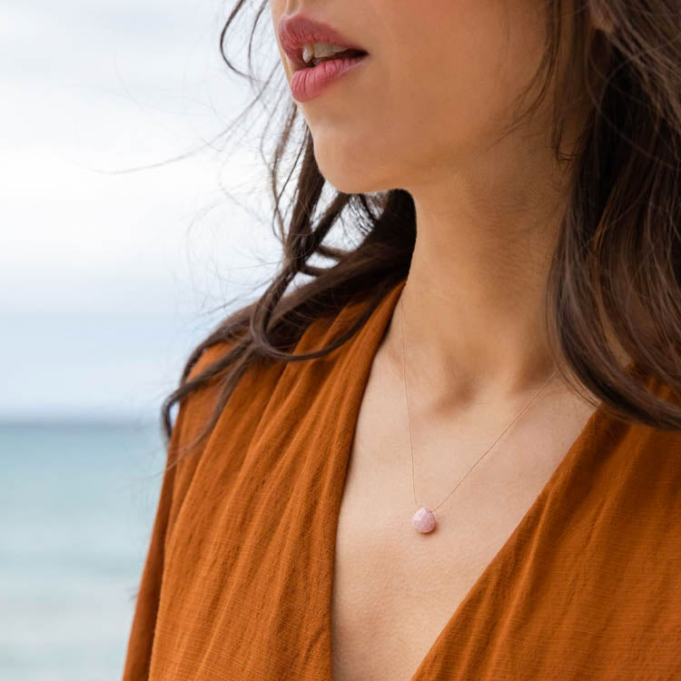 Model wearing a Wanderlust Life Pink Rhodonite Necklace