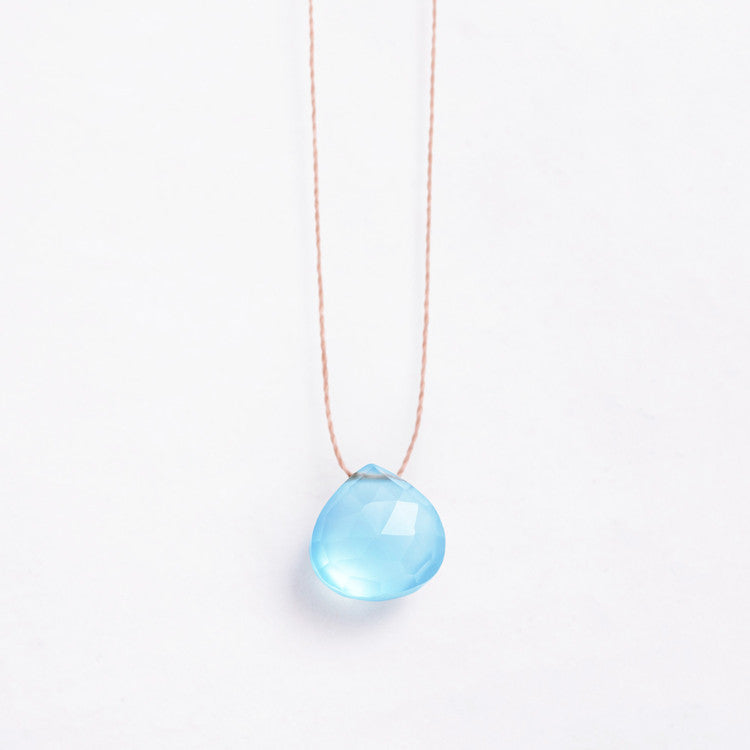 Wanderlust Life Pale Blue Chalcedony – A faceted pale blue, semi-precious stone on a natural tone thread