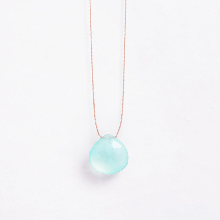 Wanderlust Life Sea Glass Chalcedony Necklace –  a faceted sea glass green, semi-precious stone on a natural tone thread