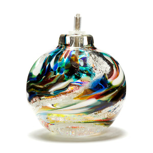 Memorial glass oil lamp containing cremated ash handmade in Ontario Canada