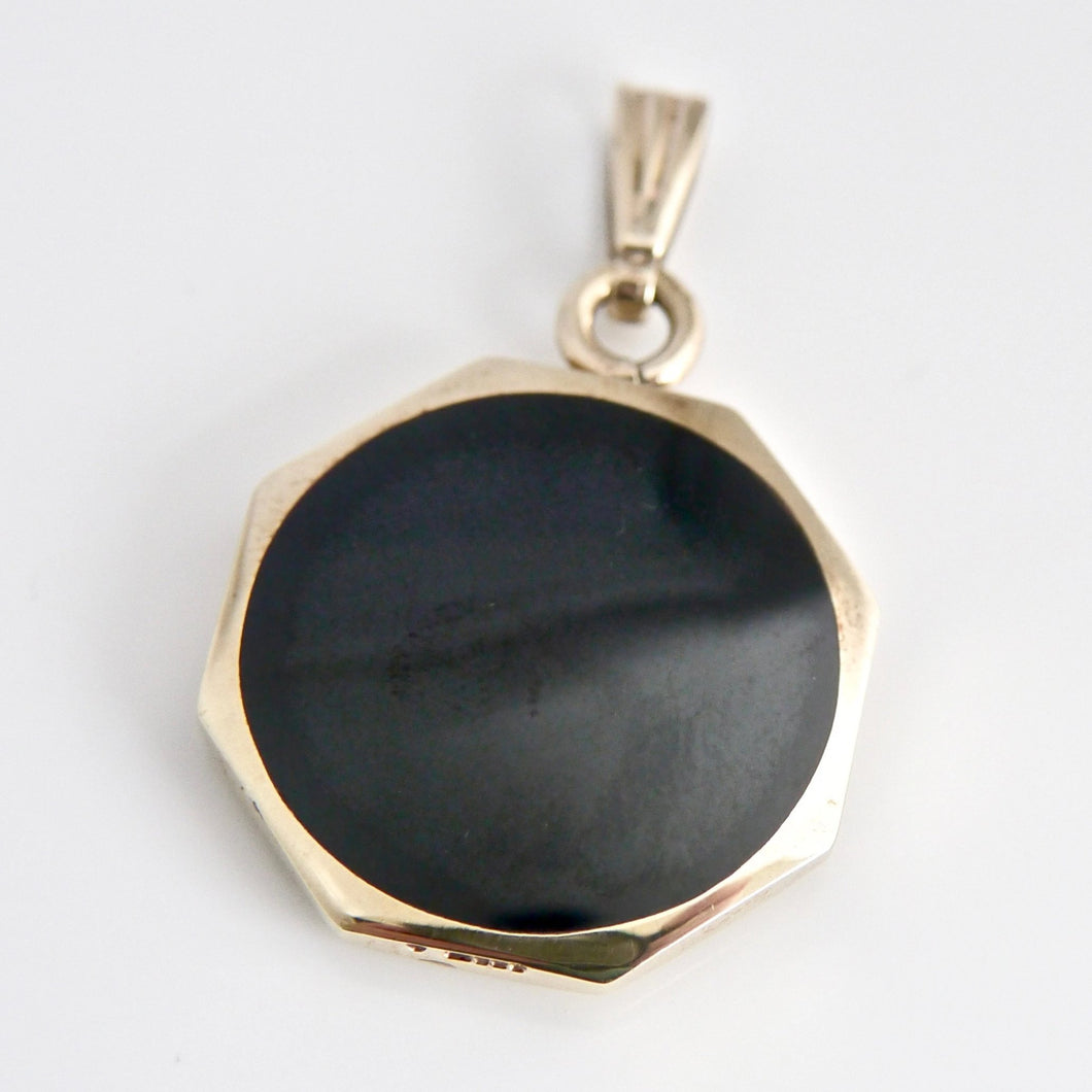 9 carat gold whitby jet reversible pendant with tigers eye designed by Andrew Thomson