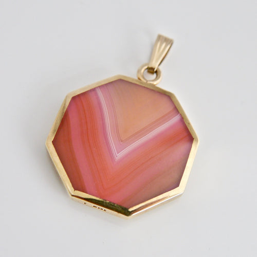 9 carat gold pink agate reversible pendant with yellow agate. Designed by Andrew Thomson