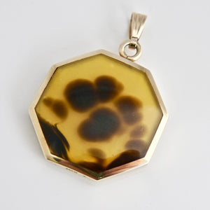 9 carat gold yellow agate reversible pendant with pink agate. Designed by Andrew Thomson