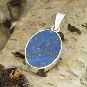 lapis pendant with blue john on the reverse side