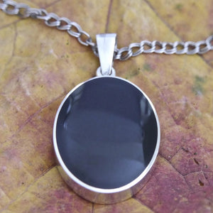 Jet oval pendant with blue john on the reverse