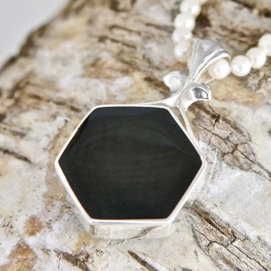 Hexagon Jet Pendant with Ammonite on the reverse.